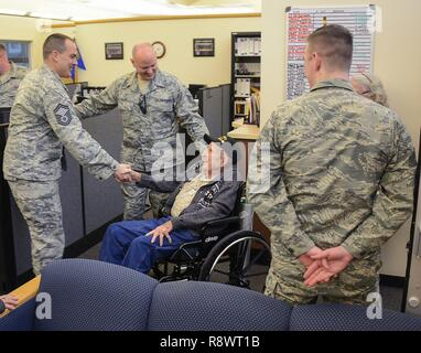 U.S. Air Force Senior Master Sgt. Nick Figueroa, 173rd Force Support Flight Superintendent, left, shakes retired Senior Master Sgt. Lyndell Crocker's hand during a tour March 14, 2017, at Kingsley Field in Klamath Falls, Oregon. More than 40 years ago, Crocker held a similar position to Figueroa when Kingsley Field was an active duty base. Crocker, a local World War II and Vietnam War veteran, was stationed at Kingsley Field from 1963 to 1969. - Stock Photo
