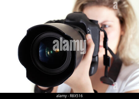 The photographer... Young woman holding a big camera - Stock Photo