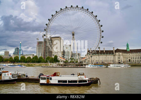 LONDON, UK - SEPTEMBER 8, 2018: attraction wheel review - London Eye. Sea Life London Aquarium on the Thames - Stock Photo