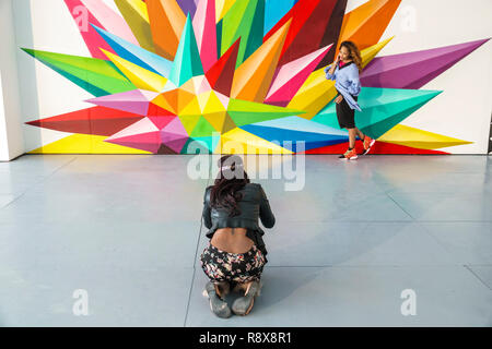 Miami Beach Florida Art Basel Weekend annual event Scope International Contemporary Art Show gallery display sale inside interior woman friends mural - Stock Photo