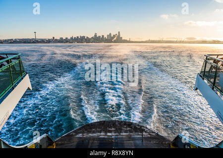 Looking back at Downtown Seattle, Washington, USA from a Washington State ferry on a cool clear Fall morning. - Stock Photo