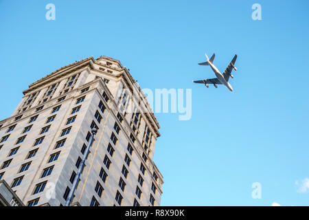 Miami Florida downtown Miami-Dade County Courthouse commercial airliner airplane plane - Stock Photo