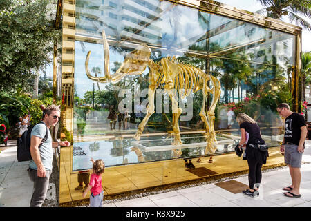 Miami Beach Florida Collins Avenue Faena hotel luxury district Art Basel Weekend Gone but not Forgotten by Damien Hirst golden wooly mammoth sculpture - Stock Photo