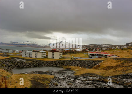Small town of Olafsvik with its typical local houses - Stock Photo