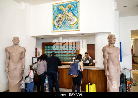 Miami Beach Florida Collins Avenue Sagamore hotel Art Basel lobby paintings sale display front reservations desk Frame - Stock Photo