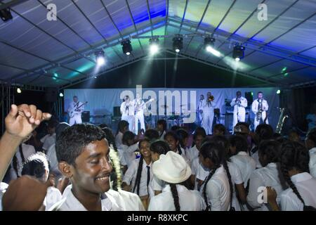 MATARA, Sri Lanka (March 14, 2017) The U.S. 7th Fleet Band, Far East Edition, performs at Matara City Center as part of Pacific Partnership 2017. Pacific Partnership is the largest annual multilateral humanitarian assistance and disaster relief preparedness mission conducted in the Indo-Asia-Pacific and aims to enhance regional coordination in areas such as medical readiness and preparedness for manmade and natural disasters. - Stock Photo