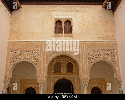Decorated wall with arches windows, detail of Nasrid Palace , Alhambra, Spain - Stock Photo