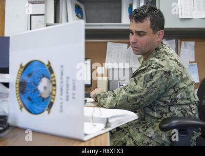 PANAMA CITY, Florida - Logistics Specialist Second Class (AW) Michael Semler tracks helicopter parts on order while on duty at the Naval Surface Warfare Center Panama City Division Aviation Unit March 16, 2017. U.S. Navy - Stock Photo