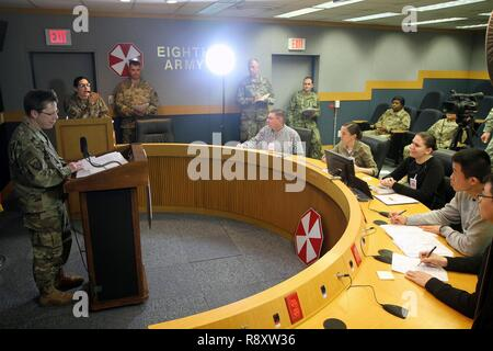 U.S. Army Maj. Gen. Tammy Smith, Eighth Army deputy commanding general – sustainment, answers questions from Soldiers with the South Dakota Army National Guard's 129th Mobile Public Affairs Detachment, who posed as civilian news media during a mock press conference during the Key Resolve training exercise at U.S. Army Garrison Daegu, South Korea, March 15, 2017. The 129th trained alongside Eighth Army Public Affairs staff to hone their public affairs and journalism skills. - Stock Photo