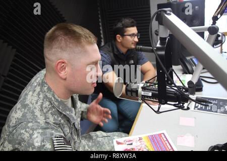 U.S. Army Sgt. Austin Pearce, 129th Mobile Public Affairs Detachment, South Dakota Army National Guard, participates in a live radio broadcast at an Armed Forces Network Korea station at U.S. Army Garrison Daegu, South Korea, March 16, 2017. 129th Soldiers trained in the Republic of Korea from March 12-23 as part of the Key Resolve exercise to sharpen their public affairs and journalism skills. - Stock Photo