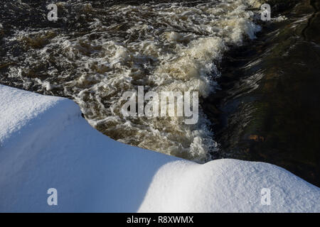 River landscape. Flowing water and snow. Natural winter background pattern - Stock Photo