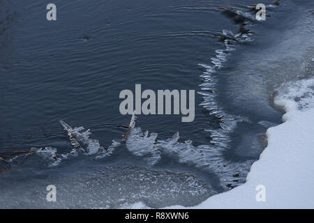 River landscape. Flowing water and ice. Natural winter background pattern - Stock Photo