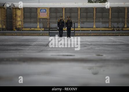 Two Union Pacific Police Honor Guardsmen standby as the funeral train, carrying the former President George H.W. Bush, heads to his final resting place after a departure ceremony at Union Pacific Westfield Auto Facility, Spring, Texas, Dec. 6, 2018. The funeral car was pulled by the 4141 locomotive and carried Bush's remains to College Station, Texas. Nearly 4,000 military and civilian personnel from across all branches of the U.S. armed forces, including Reserve and National Guard components, provided ceremonial support during the state funeral of George H.W. Bush, the 41st President of the U - Stock Photo