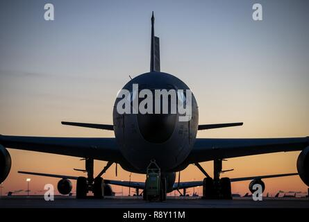 U.S. Air Force KC-135R Stratotanker refueling aircraft from the New Jersey Air National Guard's 108th Wing sit on the flight line during sunrise on Joint Base McGuire-Dix-Lakehurst, N.J., Dec. 8, 2018. The KC-135R Stratotankers assigned to the 141st Air Refueling Squadron allow the wing to support Air Mobility Command with mid-air refueling and air bridge support to overseas contingency operations and homeland defense. - Stock Photo