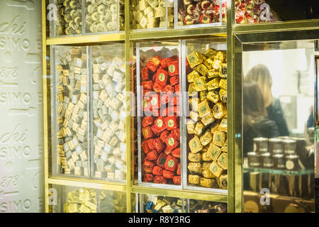 Milan, Italy - November 2, 2017: Showcase of the famous chocolate artisan Venchi in downtown Milan where chocolates are displayed on a fall day - Stock Photo
