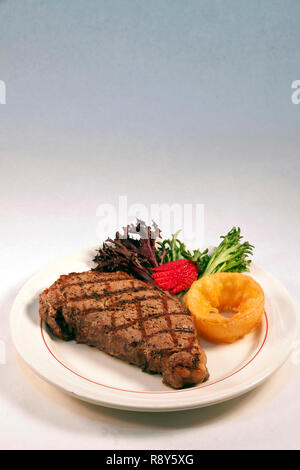 New York Strip Steak dinner with vegetables, by James D Coppinger/Dembinsky Photo Assoc - Stock Photo