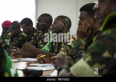 African Union Mission in Somalia (AMISOM) and Somali National Army (SNA) attend the Public Information Officers (PIO) workshop in Mogadishu, Somalia, March 1, 2017. AMISOM and SNA sector PIO's received social media, public affairs operations and effective communication training at the Joint Military Training Center during a three-day workshop. The information operation workshop was facilitated by AMISOM as part of continued efforts to counter and neutralize violent extremists in Somalia and the region. - Stock Photo