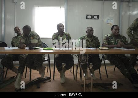 African Union Mission in Somalia (AMISOM) and Somali National Army (SNA) personnel attend the Public Information Officers (PIO) Workshop in Mogadishu, Somalia, March 1, 2017. AMISOM and SNA sector PIO's received social media, public affairs operations and effective communication training at the Joint Military Training Center during a three-day workshop. The information operation workshop was facilitated by AMISOM as part of continued efforts to counter and neutralize violent extremists in Somalia and the region. - Stock Photo