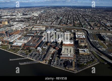"WASHINGTON (March 2, 2017) An aerial view of Naval Support Activity (NSA) Washington on the historic Washington Navy Yard (WNY). The Navy base is the ""Quarterdeck of the Navy"" and serves as the Headquarters for Naval District Washington, where it houses numerous support activities for the fleet and aviation communities. - Stock Photo"