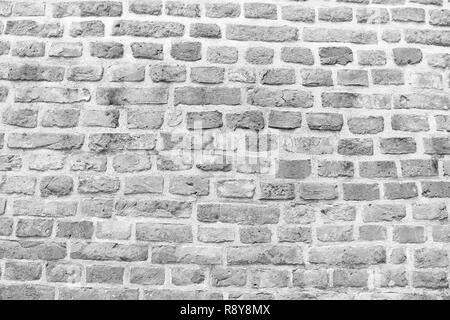 Old red brick wall in Krakow texture background. Industrial background empty grunge urban warehouse brick wall in Krakow. Old building material concept. Ancient fortification or part of defenses. - Stock Photo