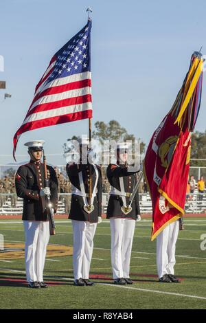 "U.S. Marines with the Official Color Guard of the Marine Corps, Battle Color Detachment, Marine Barracks Washington, D.C., perform during the Battle Color Ceremony at the 11 Area football field on Camp Pendleton, Calif., March 9, 2017. The ceremony featured ""The Commandant's Own,' the United States Marine Drum & Bugle Corps, the Silent Drill Platoon, and the Official Color Guard of the Marine Corps. - Stock Photo"
