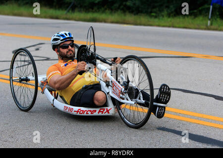Man in a fitness wheelchair cycle participating in the 2018 Dayton Air Force marathon. - Stock Photo