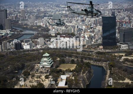 AH-1Z Vipers soar through the skies over Osaka Castle, Osaka, Japan, March 12, 2017. Marine Light Attack Helicopter Squadron 267 validated the long-range capability of the auxiliary fuel tanks on their H-1 platform helicopters by flying 314 nautical miles during one leg of the journey, March 10. These aircrafts' extended range is crucial to maintaining a stronger, more capable forward-deployed force in the Asia-Indo-Pacific region. The Marines in the aircraft are with HMLA-267, currently assigned to Marine Aircraft Group 36, 1st Marine Aircraft Wing, III Marine Expeditionary Force through the  - Stock Photo