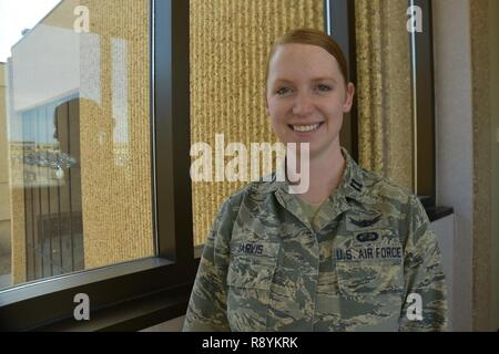 Capt. Kara Jarvis, 50th Space Wing Network Operations Group, Commander's Action Group chief, connects with her Irish-American heritage through her red hair at Schriever Air Force Base, Colorado, March 9, 2017.  Western Europe houses more redheads than anywhere else in the world, with approximately ten percent in Ireland. - Stock Photo