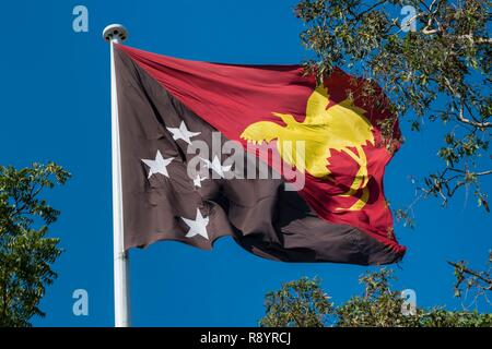 Papua-New-Guinea, Gulf Papua area, National Capital District area, Port Moresby town, official flag of the country - Stock Photo