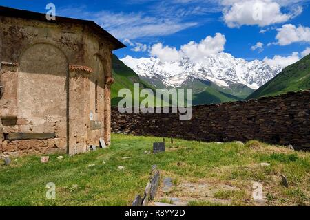 Georgia, Upper Svaneti (Zemo Svaneti), village of Ushguli, listed as World heritage by UNESCO, Lamaria St. Mary's church of Ushguli from the 12th century and Mount Chkhara (highest peak in Georgia with 5,193 m) in the background - Stock Photo