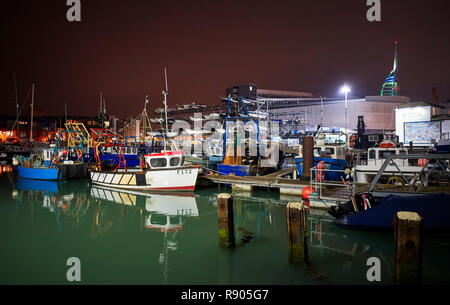 Camber Docks in Portsmouth at night with small inshore fishing vessels in foreground - Stock Photo
