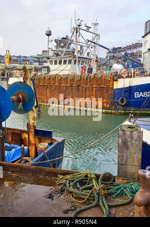 Rusty fishing vessels in the harbour at Camber Docks, Portsmouth - Stock Photo
