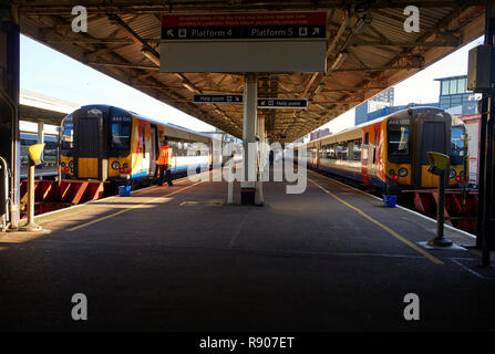 Two South West electric trains at the Portsmouth Harbour station platform - Stock Photo