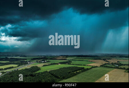 Storm above the wooded countryside of Vendee with heavy rainfall and wind, aerial view from a drone, on 2018/06/08 *** Local Caption *** - Stock Photo