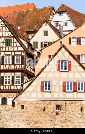 historic half-timbered houses  in schwaebisch hall seen from the shore of river kocher - Stock Photo