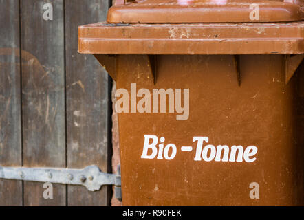 brown trashcan with the german inscription: 'bio-tonne', trashcan for organic waste - Stock Photo