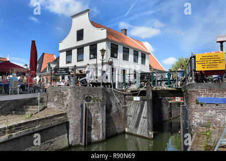 Café t Sluis old, brown café 100 years building 1565, terrace on the water, (a side channel of t IJ), Amsterdam Noord - North, The Netherlands, Dutch, - Stock Photo