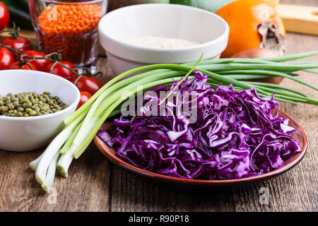 Healthy plant based vegan food. Variety of fresh  vegetables, fruits, dried grains and beans, close up, selective focus - Stock Photo