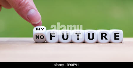 Hand is turning a dice and changes the expression 'no Future' to 'my Future' - Stock Photo