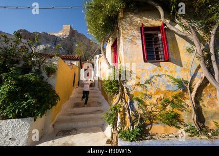 Athens. Greece. Cycladic style architecture of Anafiotika on the edge of the Plaka district nestles against the Acropolis. - Stock Photo