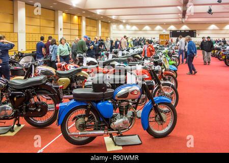 Visitors looking at vintage motorbikes / motorcycles at the Shetland Classic Motor Show in Lerwick, Shetland Islands, UK - Stock Photo