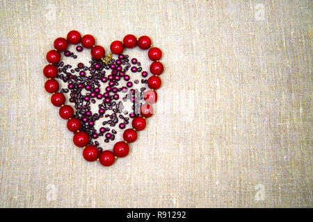 Beads in the shape of a heart. Copy space. - Stock Photo