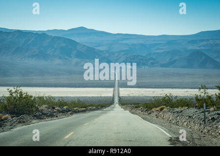 View from the endless road through Death Valley National Park (California State Route 190), with a view of the Sierra Nevada mountains in the backgrou - Stock Photo