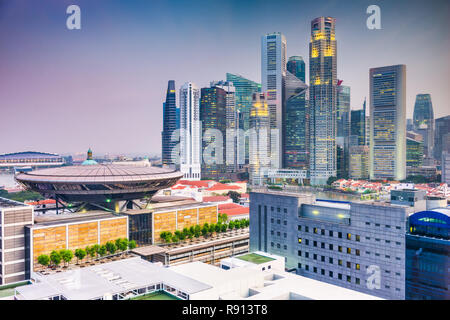 Singapore downtown skyline with the Supreme Court Building at twilight. - Stock Photo