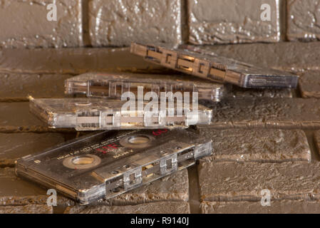 Old cassette tapes on the black table, Spain - Stock Photo