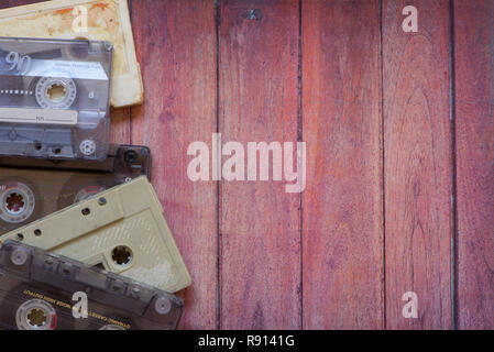 Old cassette tapes on the wooden brown table - Stock Photo