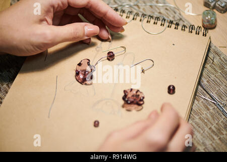 Female Artist Creating Jewelry Close up - Stock Photo