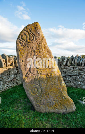 Early Medieval Standing Stone, The Serpent Stone,  by roadside at Aberlemno, Angus Scotland UK against a bright blue cloudy sky