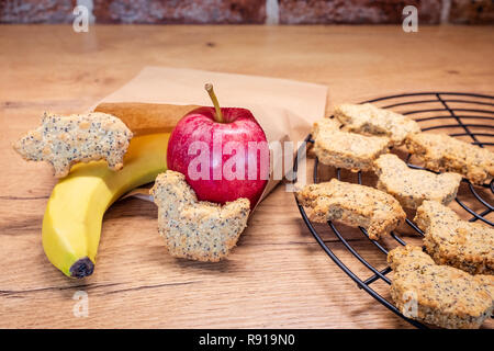 Plastic free healthy school or work snack in recycled paper snack bag using authentic real homemade food. Authentic real food. - Stock Photo