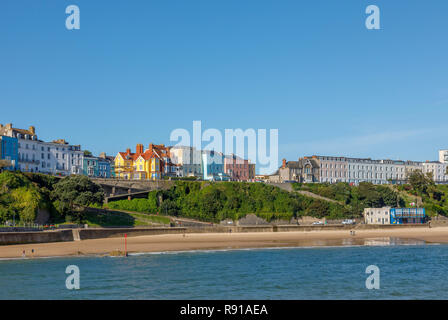 Colourful houses above the harbour and North Beach in Tenby, a walled seaside town in Pembrokeshire, south Wales coast, western side of Carmarthen Bay - Stock Photo